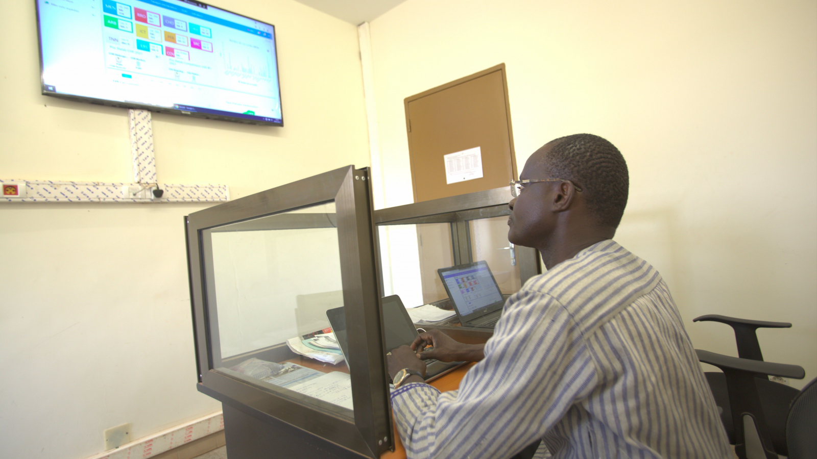 Dr. Yameogo interacting with the STELab dashboard to monitor bacterial meningitis across the country. (Photo Credit: Human Interest Documentaries / Davycas International, 2021)